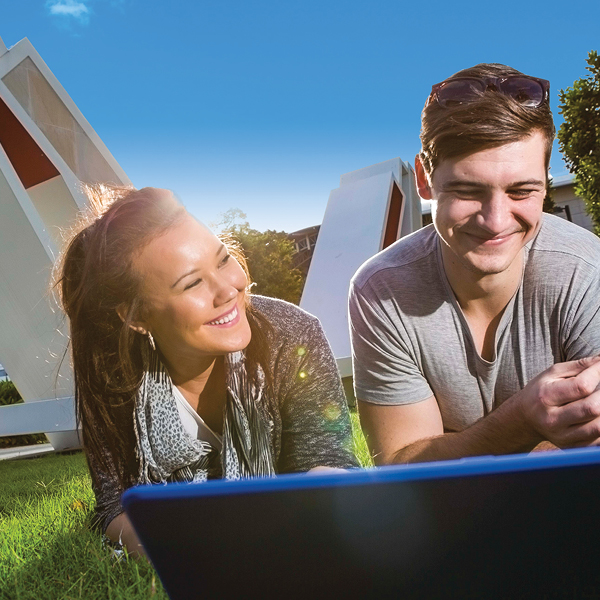 generic-imagery-campus-girl-and-guy-laptop-smiling-on-greenspace-tile-600x600.jpg